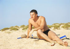 man sits on sand Stock Images