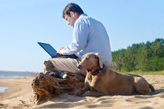 The man sits on seacoast Stock Photos