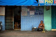 Man sits on street cart Stock Photo