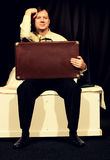 Man Sits with Suitcase Royalty Free Stock Images