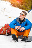A man sits in a tent in the winter. Royalty Free Stock Images
