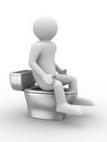 Man sits on toilet bowl Stock Photo
