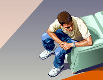 Man Sitting. Young man with jeans and tennis shoes sitting waiting. View from above Royalty Free Stock Images