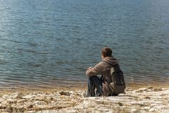 Man sitting alone and watching on the lake Royalty Free Stock Photos