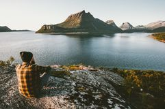 Free Man Sitting Alone Enjoying Sea And Mountains View Royalty Free Stock Photo - 113869235