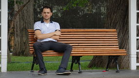 Man Sitting Alone On Park Bench Stock Photography