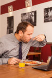 Man sitting alone in restaurant with laptop Royalty Free Stock Photography