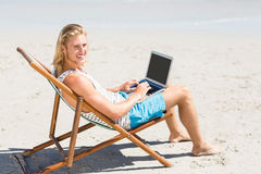 Man sitting on armchair at beach Royalty Free Stock Images