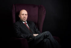Man sitting in the armchair royalty free stock image
