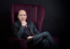 Man sitting in the armchair stock photos