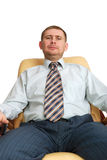 Man sitting on the armchair isolated on white back Royalty Free Stock Photography