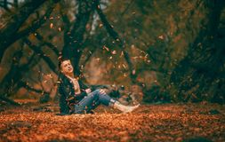 Man sitting among Autumn leaves Royalty Free Stock Photo
