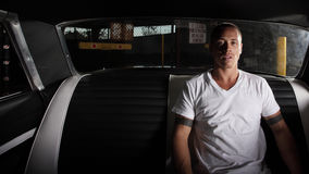 Man sitting in the back seat of his car Royalty Free Stock Photo