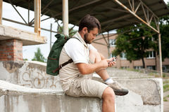 Man sitting with backpack on his back Royalty Free Stock Photos