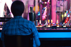 Man sitting in a bar Royalty Free Stock Images