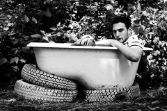 Man sitting in the bathtub Stock Photography