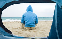 Man sitting on beach. Stock Photo