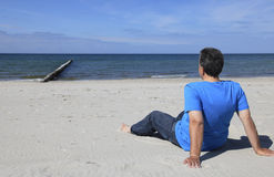 Man sitting on the beach Stock Photo