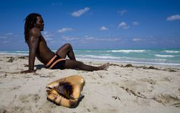 Man sitting on the beach in cuba Stock Photos