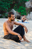Man sitting on a beach Royalty Free Stock Image