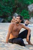 Man sitting on a beach Royalty Free Stock Photo