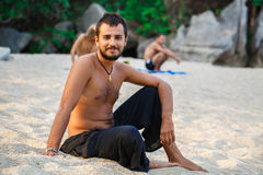 Man sitting on a beach Royalty Free Stock Photography