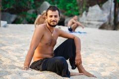 Man sitting on a beach Stock Image