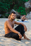 Man sitting on a beach Royalty Free Stock Photos