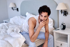Man sitting bed Royalty Free Stock Photos