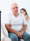 Man sitting in bed and quarrelling with  wife. Royalty Free Stock Photos
