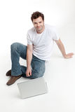 Man sitting behind blanck laptop smiling Stock Photography