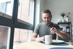 Man eating breakfast in the morning Royalty Free Stock Image