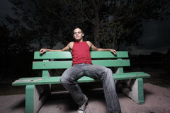 Man sitting on a bench Stock Images