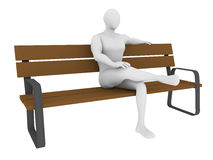 A man sitting on a bench Stock Photography
