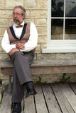 Man sitting on bench Stock Image