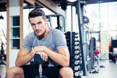 Man sitting on the bench with dumbbells at gym Royalty Free Stock Photography