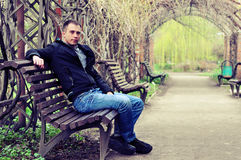 Man sitting on a bench Royalty Free Stock Photos