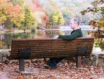 Man sitting on a bench Stock Photography