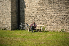 Man sitting on a bench Stock Image