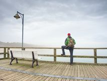 Man sitting in the bench on the Sea Bridge royalty free stock photography