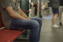 Man sitting in a bench in an underground station Royalty Free Stock Photos