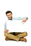 Man sitting with blank poster Royalty Free Stock Images