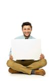 Man sitting with blank poster Stock Photography