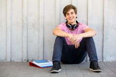 Man sitting with books. Young man sitting with books Royalty Free Stock Photos
