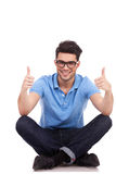 Man sitting both thumbs up Royalty Free Stock Photo