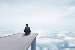 Man sitting on bridge Stock Image