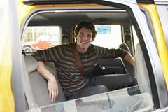 Man Sitting In A Cab Stock Image