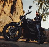 Man sitting on a cafe-racer motorcycle royalty free stock images
