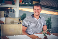 Man sitting at cafe or street restaurant Stock Photo