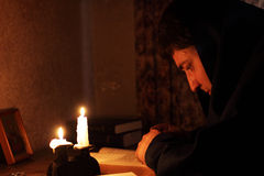 Man sitting by candlelight Stock Photo